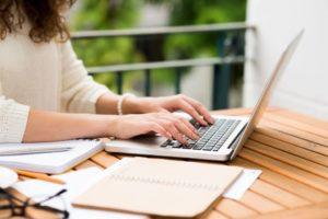 Lady at Computer Keyboard
